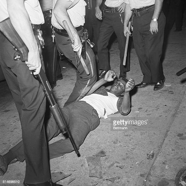 Police subdue a rioter during the third night of race riots in Paterson New Jersey