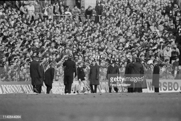 Police supervising fans at Portsmouth v Southampton match at Fratton Park, Portsmouth, UK, 30th January 1984.