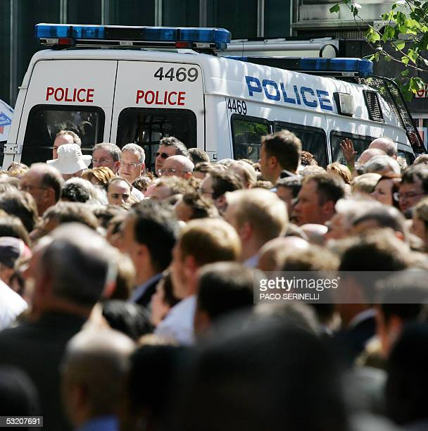 Police supply security as thousands of commuters try to enter Fenchurch Street after subway and bus lines were closed after terrorist attacks in...