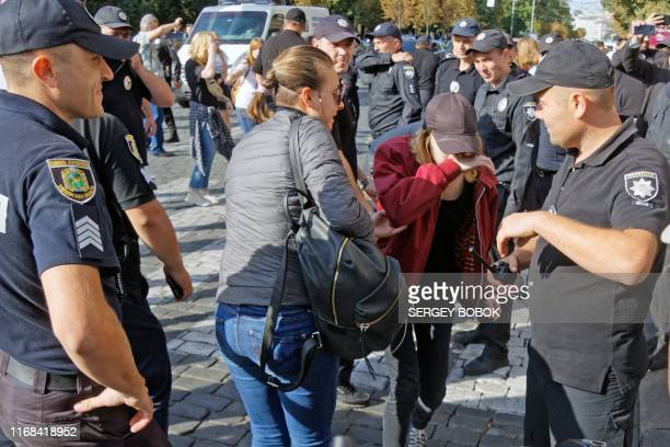 Police surround activists from the LGBT community after being attacked during Kharkiv Pride march in the Ukrainian city of Kharkiv on September 15...