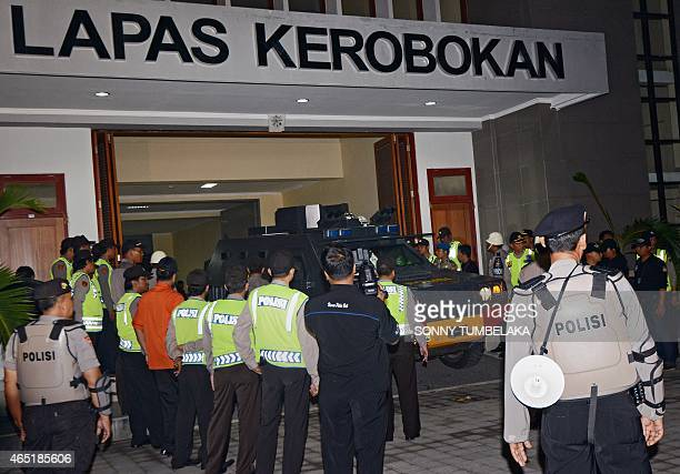 Police surround an Indonesian police vehicle used to transfer two Australian drug smugglers on death row outside Kerobokan prison in Denpasar on Bali...