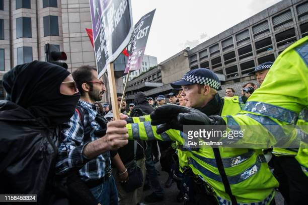 Police surround and detain anti fascists heading towards a protest by the racist English Defence League on September 7 2013 in London United Kingdom...