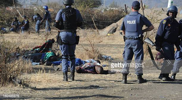 Police surround miners killed during clashes between protesting miners and police near a platinum mine in Marikana on August 16 2012 An illegal...