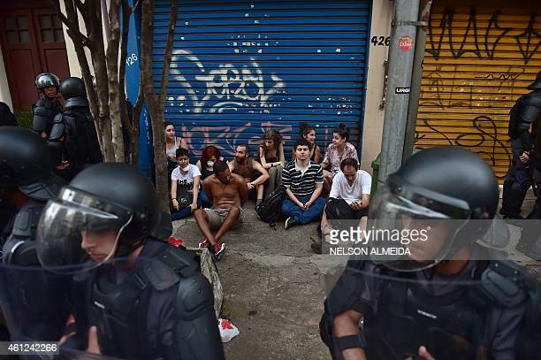 Police surround students arrested during a protest against the rise of the public bus and subway's fare in Sao Paulo Brazil on January 9 2015 AFP...