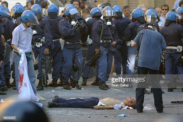 Police surround the body of Carlo Giuliani a demonstrator they shot to death July 20 2001 during protests in central Genoa Approximately 600 violent...