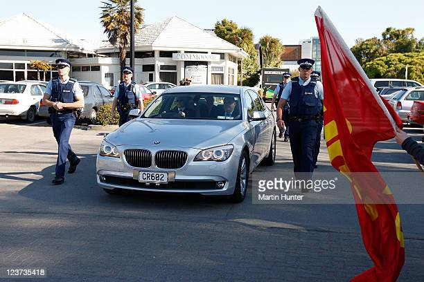 Police surround the car of a New Zealand Cabinet Minister as he leaves an historic post cabinet press conference on September 5 2011 in Christchurch...