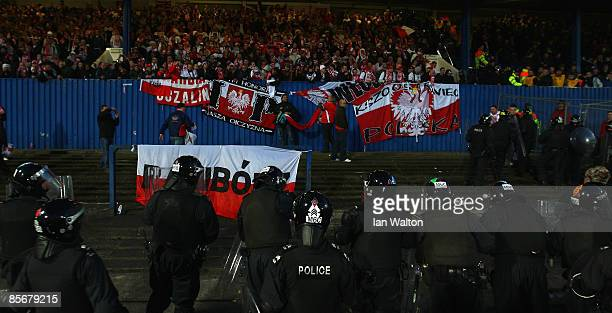 Police surround the polish fans during the FIFA2010 World Cup Qualifier match between Northern Ireland and Poland at Windsor Park on March 28 2009 in...