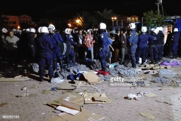 Police surrounds migrants to move them away after farright group launched a violent attack overnight on migrants staging a sitin protest on the Greek...