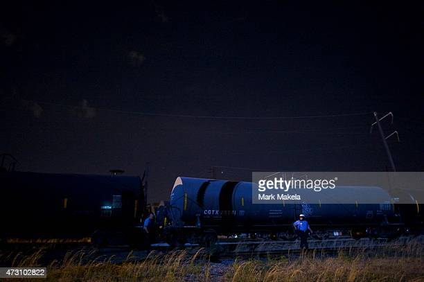 Police survey the scene of wreckage from an Amtrak passenger train carrying more than 200 passengers from Washington DC to New York that derailed May...