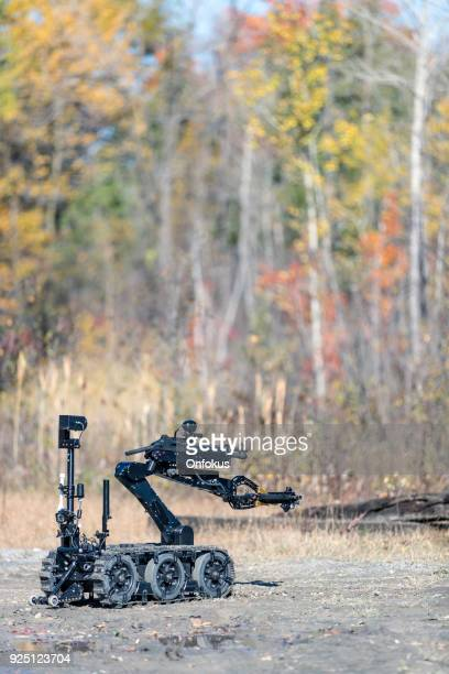 police swat officer using a mechanical arm bomb disposal robot unit - detonator stock photos and pictures