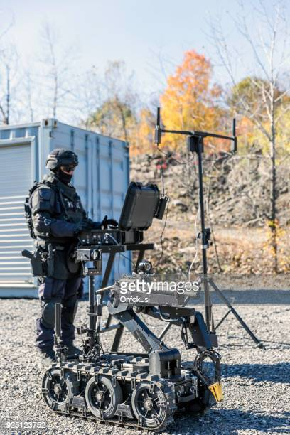 Police Swat Officer Using a Mechanical Arm Bomb Disposal Robot Unit