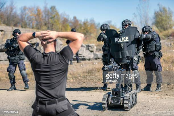 Police Swat Team Officers Using a Mechanical Robot Unit