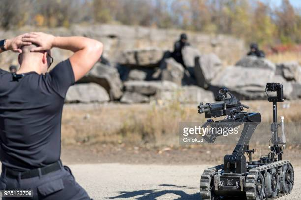 police swat team officers using a mechanical robot unit - detonator imagens e fotografias de stock