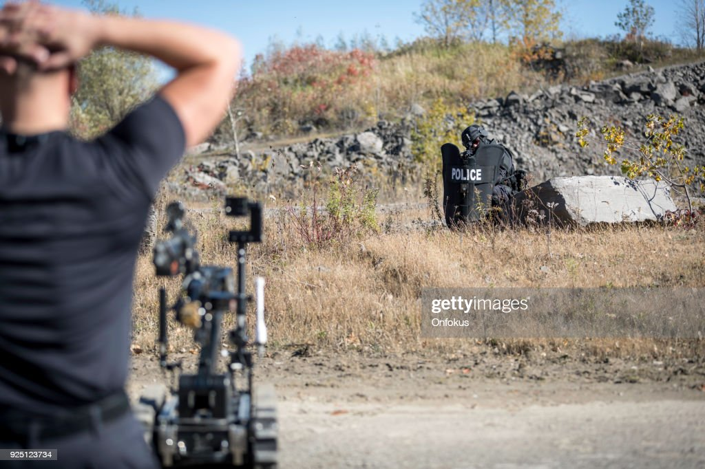 Police Swat Team Officers Using a Mechanical Robot Unit : Stock Photo