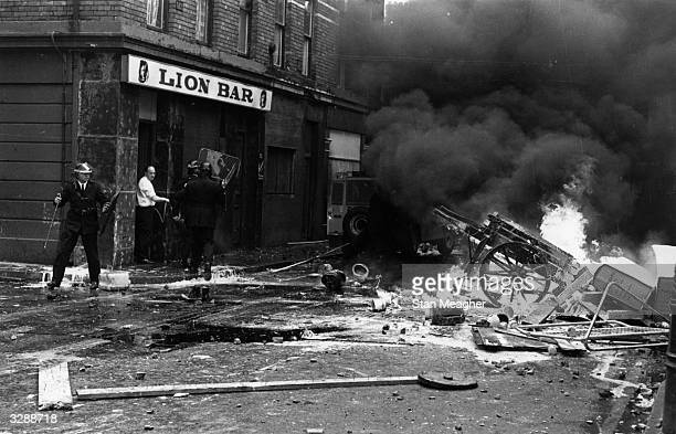 Police tackle street fire on the streets of Derry City when violence broke out during a civil rights march in the Bogside