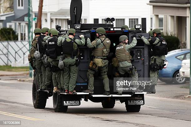 A police tactical unit drives through the streets as they search for 19yearold bombing suspect Dzhokhar A Tsarnaev on April 19 2013 in Watertown...