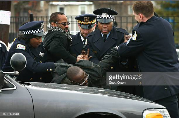 Police take a man into custody outside the Greater Harvest MB Church before the start of a funeral for 15yearold Hadiya Pendleton on February 9 2013...