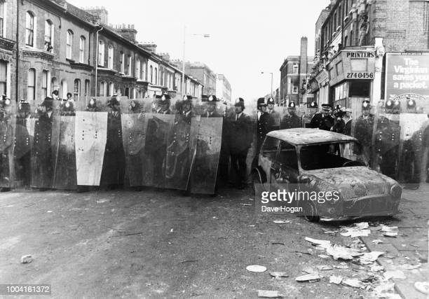 Police take action in the streets of Brixton during the Brixton riots in London 1981
