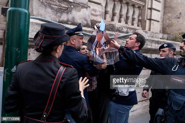 Police take away posters from demonstrators of the No War Network protesting U.S. President Donald Trump upon his departure of the Quirinale...