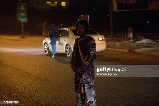 Police take measurements at a street due to the partial curfew imposed as a precaution against coronavirus in Khartoum, Sudan on March 24, 2020....