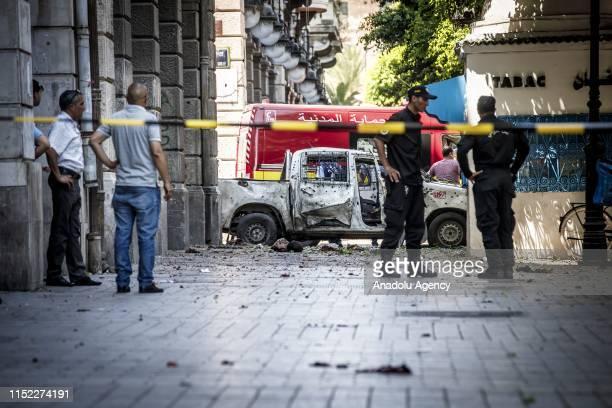 Police take measures after a suicide bombing targeted a police vehicle in the Tunisian capital in Tunis on June 27 2019