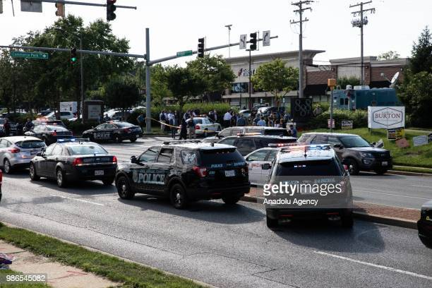 Police take measures after multiple people have been fatally shot and wounded when a gunman opened fire at the Capital Gazette newsroom in Annapolis...