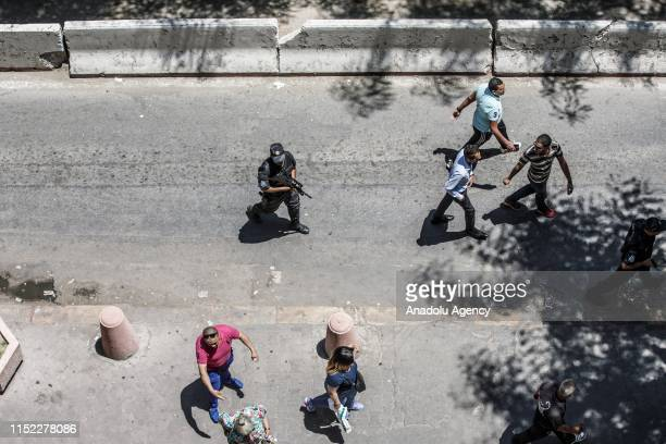Police take measures at the scene after a suicide bombing targeted a police vehicle in the Tunisian capital in Tunis Tunisia on June 27 2019 At least...