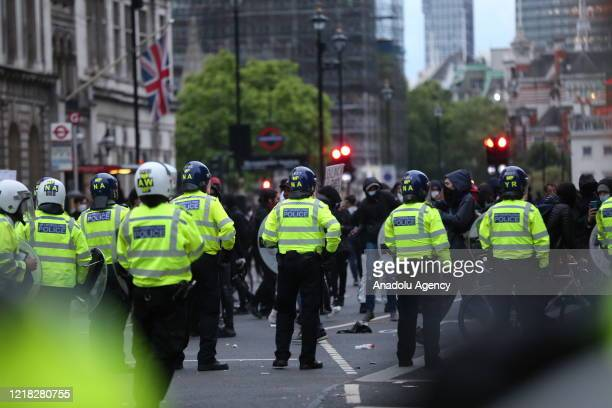 Police take measures during a Black Lives Matter protest near British Foreign and Commonwealth Office and Prime Minister's Office on June 07, 2020 in...