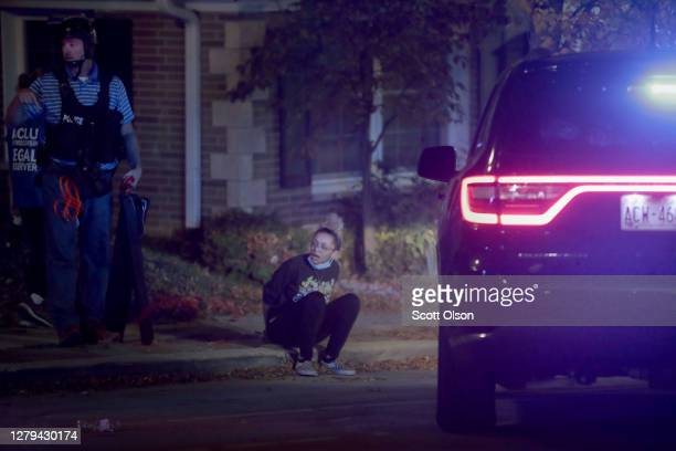Police take people into custody who were out after curfew follow a brief skirmish with demonstrators near the Wauwatosa City Hal on October 09, 2020...