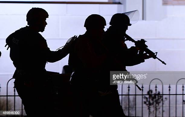 Police take position during clashes with protesters following the decision in the shooting death 18yearold Michael Brown in Ferguson Missouri on...
