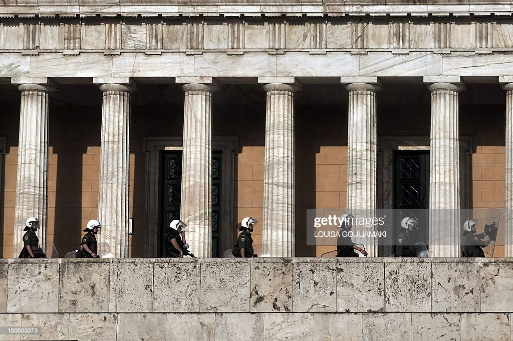 Police take positions in front of the Greek parliament on May 6, 2010. More than 10,000 people demonstrated in the Greek capital as lawmakers voted on a drastic austerity package, a day after protests against cutbacks degenerated into deadly riots .