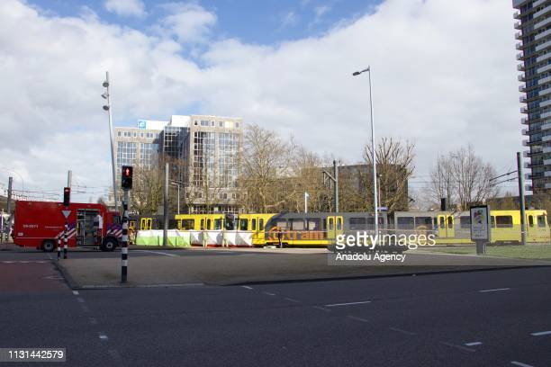 Police take security measurements at the area after three people were killed when a gunman opened fire on tram passengers in Utrecht, Netherlands on...
