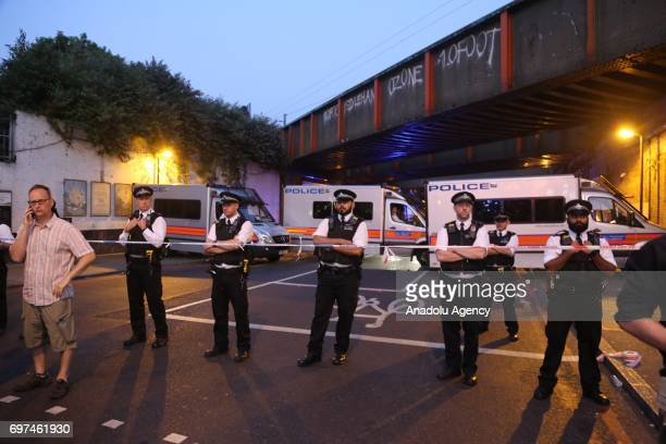 Police take security measures after a vehicle mows down Muslim worshippers on the sidewalk near the Finsbury Park Mosque on Seven Sisters Road in...