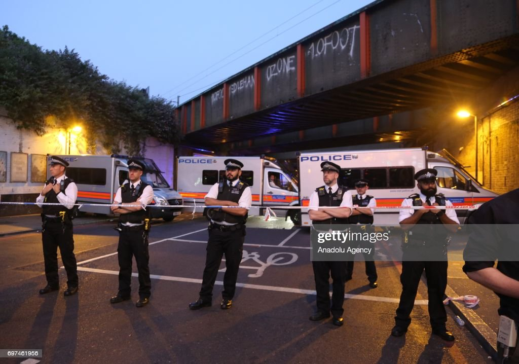 Police take security measures after a vehicle mows down Muslim worshippers on the sidewalk near the Finsbury Park Mosque on Seven Sisters Road in London, England, United Kingdom on June 19, 2017.