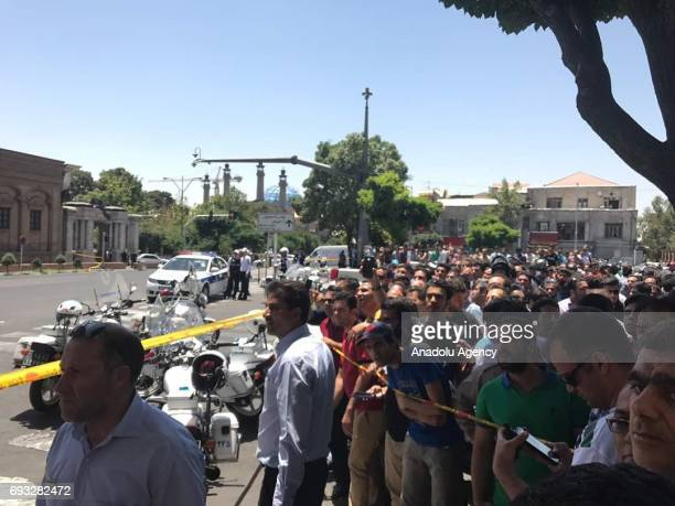 Police take security measures and people gather near the scene after gunmen opened fire at Irans parliament and the shrine of Ayatollah Khomeini in...