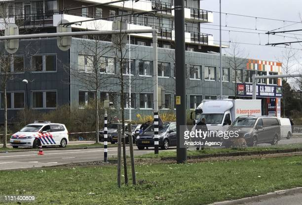 Police take security measures around the scene after a gunman opened fire on tram passengers in Utrecht Netherlands on March 18 2019 The attack was...