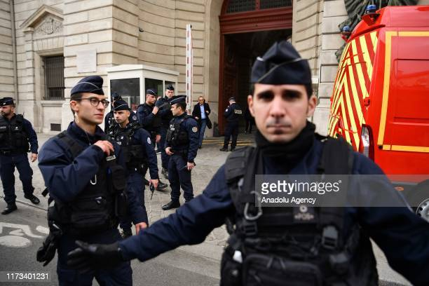 Police take security measures as French Interior Minister Christophe Castaner holds a press conference outside Paris police headquarters after a...