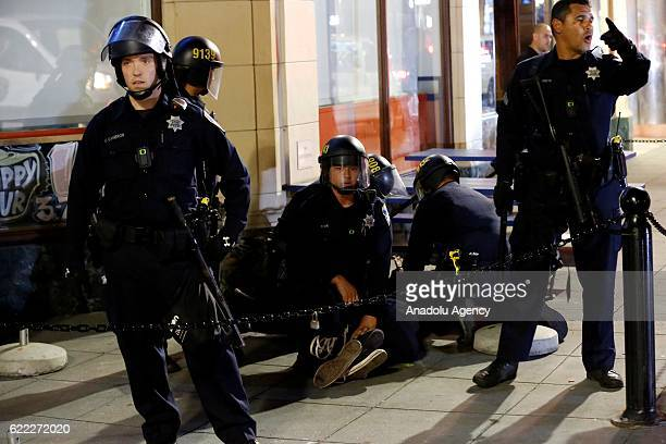 Police take security measures as protesters gather and block the roads of the downtown of Oakland during a protest against Presidentelect Donald...