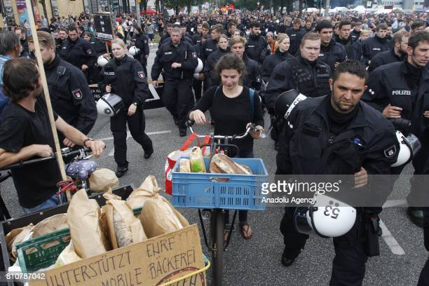 Police take security measures as protesters march during the 'G20 Not Welcome' protests against G20 Leaders' Summit on its second day in Hamburg...