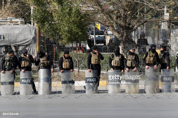 Police take security measures as supporters of Shiite cleric Muqtada alSadr stage a protest demanding change of the Iraq's Independent High Electoral...