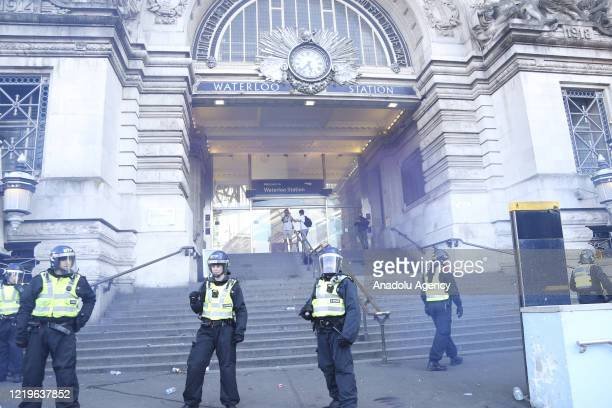 Police take security measures as they try to prevent clashes between Far-Right protesters and a group of Black Lives Matters protesters in front of...