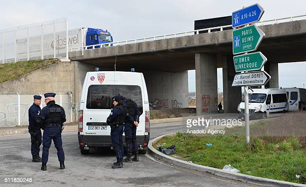 """Police take security measures at the camp known as the """"Wild Jungle"""" on February 23, 2015 in Calais, France as evacuation deadline comes close to an..."""