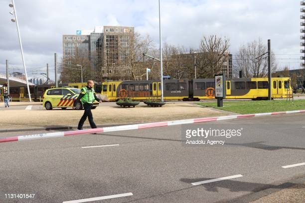 Police take security measures at the scene after a gunman opened fire on tram passengers and in injured several in Utrecht Netherlands on March 18...