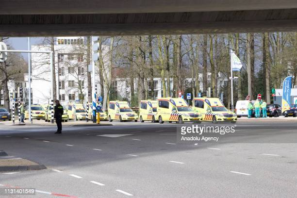 Police take security measures at the scene after a gunman opened fire on tram passengers and in injured several in Utrecht, Netherlands on March 18,...