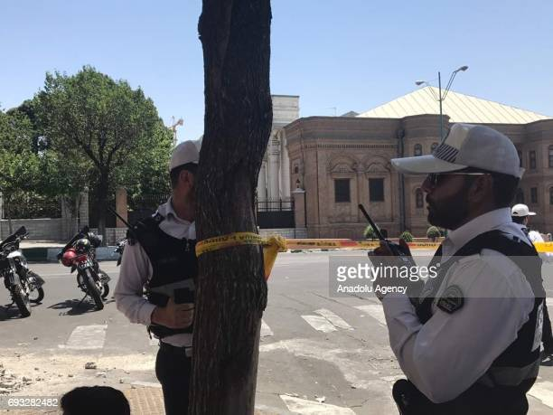 Police take security measures at the scene after gunmen opened fire at Irans parliament and the shrine of Ayatollah Khomeini in the capital Tehran...