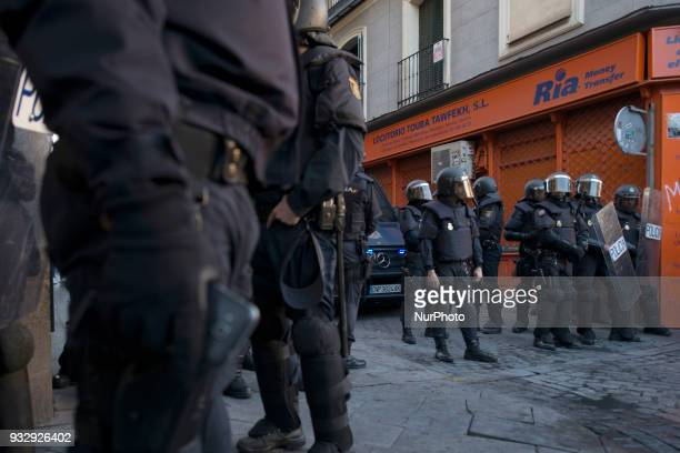 Police take security measures during a protest in support of Mmame Mbage at Plaza de Nelson Mandela in the Lavapies district on March 16 2018 in...
