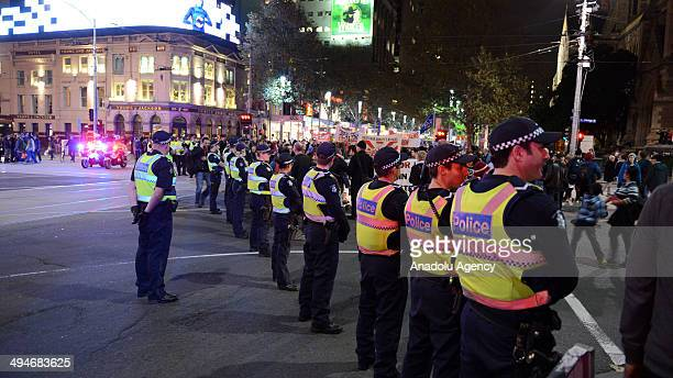 Police take security measures during the protest in Melbourne Australia on 30 May 2014 People gather to protest Australia Federal Government's new...