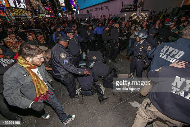 Police take some avtivists as protestors block the 5th Avenue during the protests in New York City on November 25, 2014 after the grand jury...