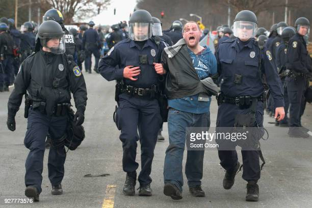 Police take someone into custody following a clash between white nationalists and counterdemonstrators before the start of a speech by white...