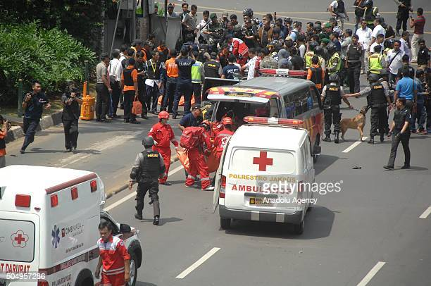Police take the bodies of civilian victims of terrorist bomb explosion at the traffic police station to a hospital in Sarina Jakarta on January 14...